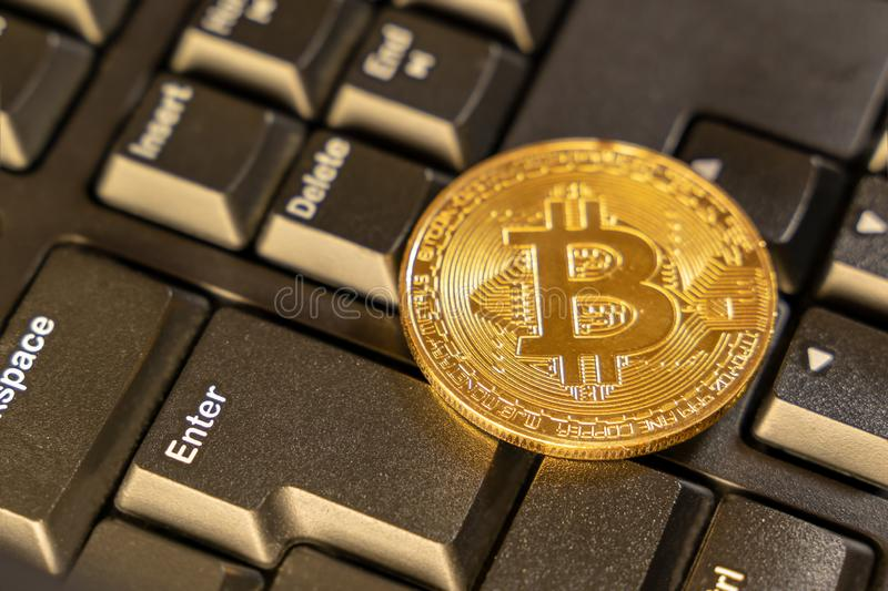 Close up bitcoin on top of computer keyboard at background, cryptocurrency accepting for payment and finance concept royalty free stock photo