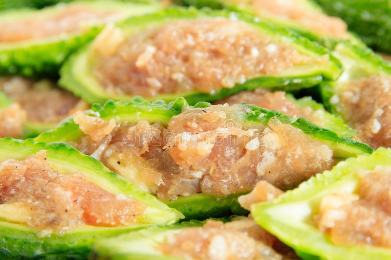 Close up bitter gourd pile with stuffed hack pork and garlic black pepper ingredient. vegetable herb Nourish the health body royalty free stock image