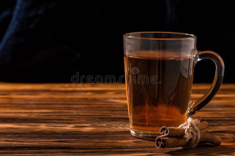 Close up. Black aromatic tea in a glass transparent cup. stock photo