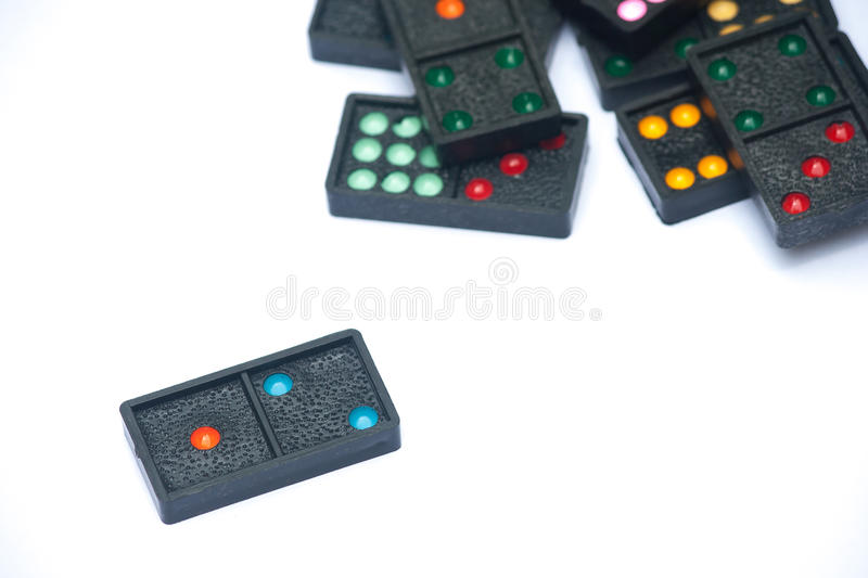 Close Up Black Color Dominoes With Colorful Dot Pieces Lie ...