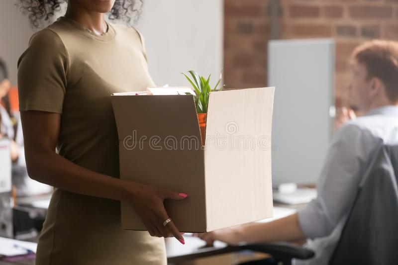 Close up of black employee hold box with belongings stock photo