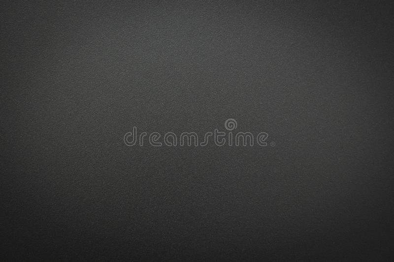 Close-up of black gray metal texture. Surface of rough abstract dark black matte background. royalty free stock image