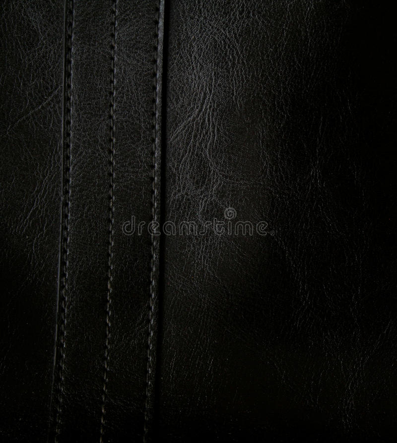 Close-up of black leather texture as background. Close-up of black leather texture can use as background royalty free stock photography