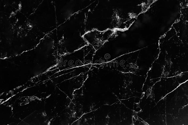 Black marble texture with natural white line patterns background royalty free stock photography