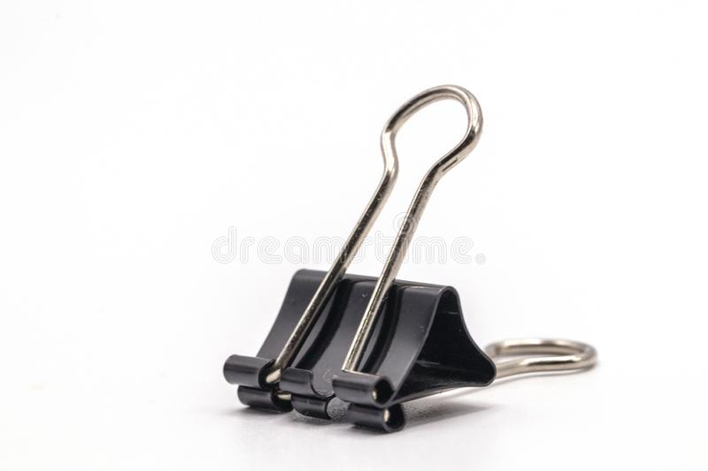 Close up black paper clip isolate on white background.Selective object on white. royalty free stock images