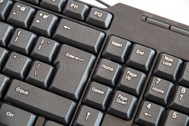 The Close-up of black PC keyboard with selective focus button. Close-up of black PC keyboard with selective focus button stock photo