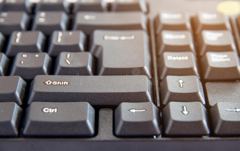 The Close-up of black PC keyboard with selective focus button. Close-up of black PC keyboard with selective focus button stock images