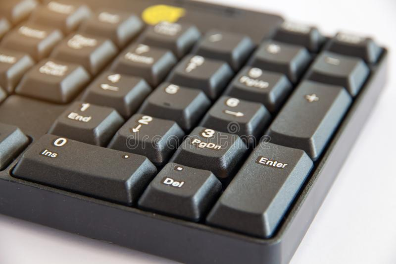 The Close-up of black PC keyboard with selective focus button. Close-up of black PC keyboard with selective focus button royalty free stock photography