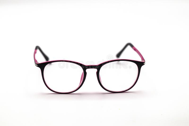 Close up black and pink eye glasses on white background. royalty free stock images