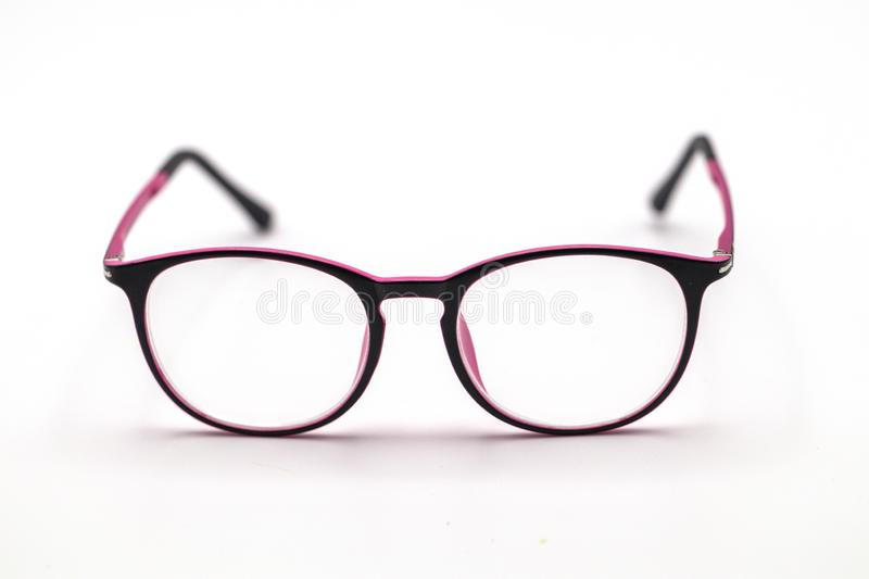 Close up black and pink eye glasses on white background. stock photo
