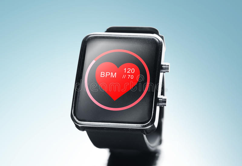 Close up of black smart watch with heart beat icon royalty free stock photo