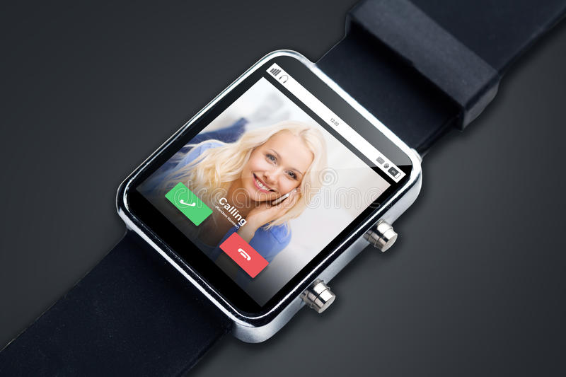 Close up of black smart watch with incoming call. Modern technology, object, communication and media concept - close up of black smart watch with incoming call royalty free stock photos