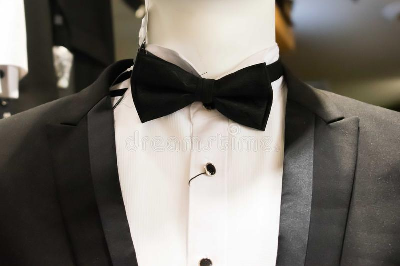 Close up of black tuxedo with a bow tie stock image
