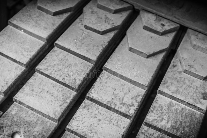 Close-up black and white photo of a stack of railroad car leaf springs. royalty free stock images