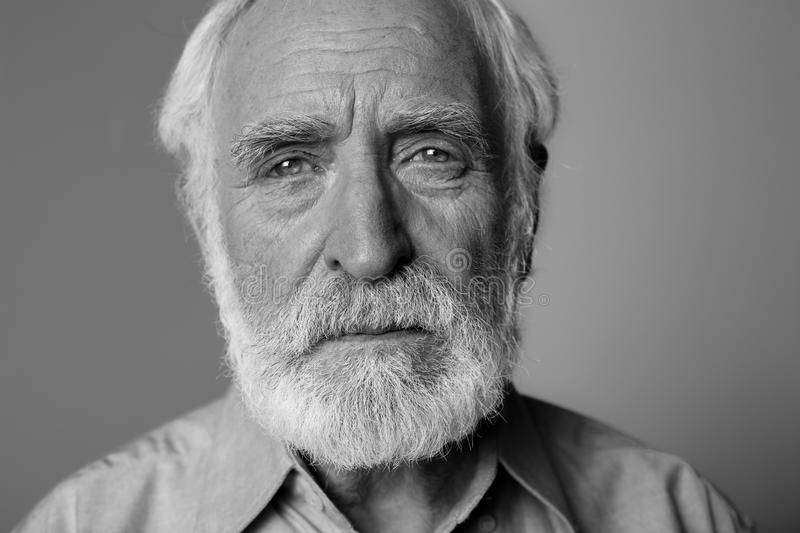 Download wrinkled old man expressing emotional pain stock photo image of casual male