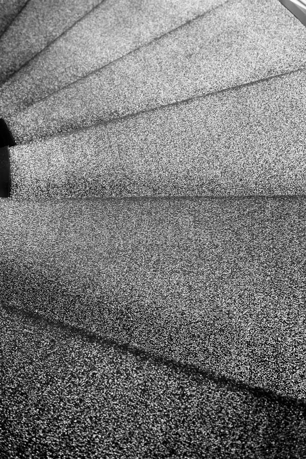 Close up black and white spiral staircase stock image
