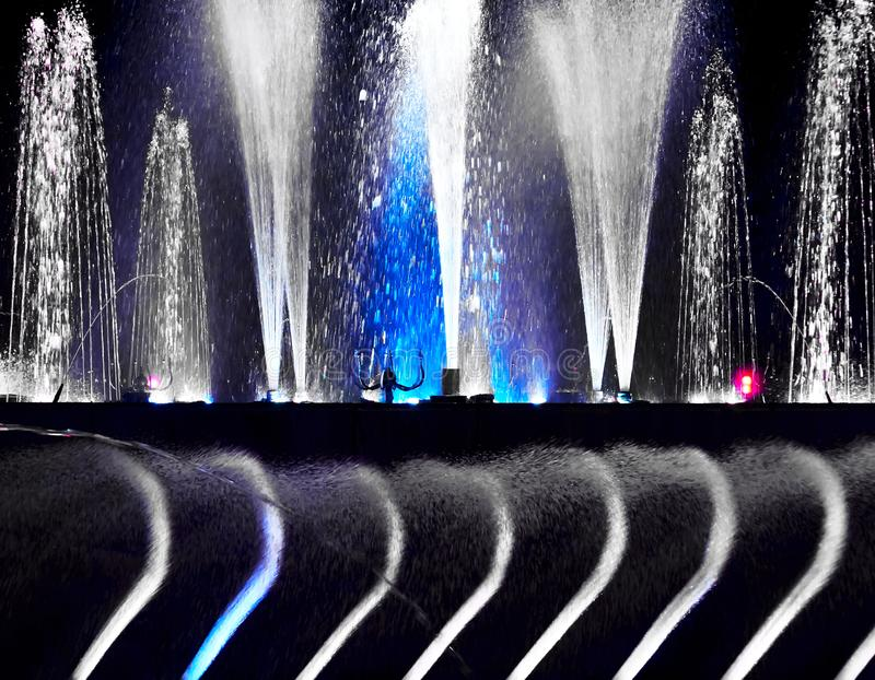 Close-up of a black and white water fountain in Manila. Close-up of a beautiful black and white water fountain operated at nighttime in Manila, Philippines royalty free stock image