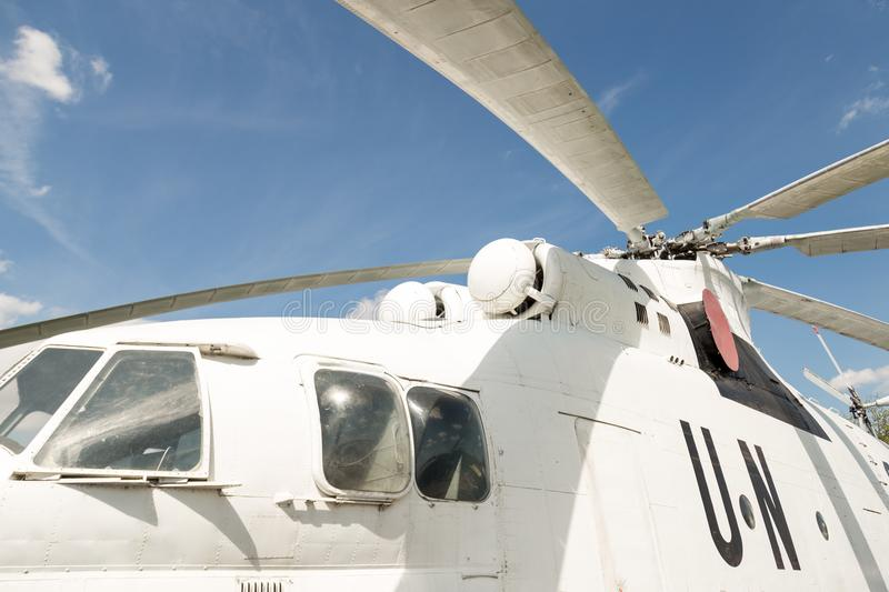 Close-up blade rotors and engine of big cargo-passenger U.N. helicopter against blue sky on background royalty free stock photography