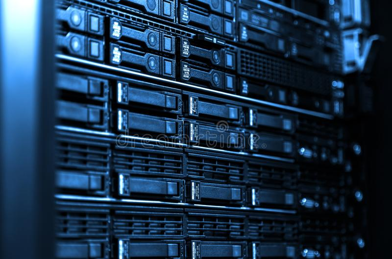 Close up blade server equipment rack in big data center with blurred side frame cold blue tone royalty free stock photos