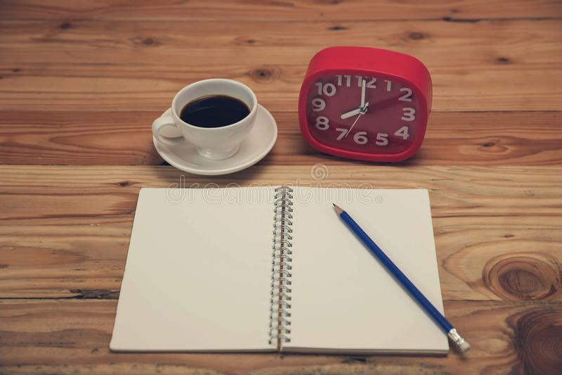 Close up blank notebook on office desk in working hours royalty free stock image