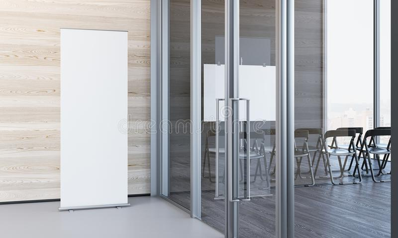 Close up of blank white roll up in modern office with wooden walls, 3d rendering. Close up of blank white roll up next to meeting room in modern office with stock photos