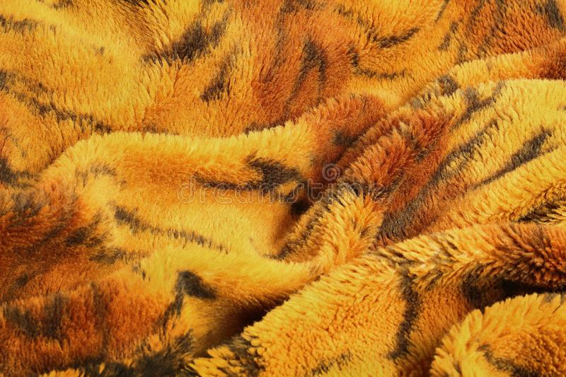 Close up of blanket in tiger pattern texture background stock image