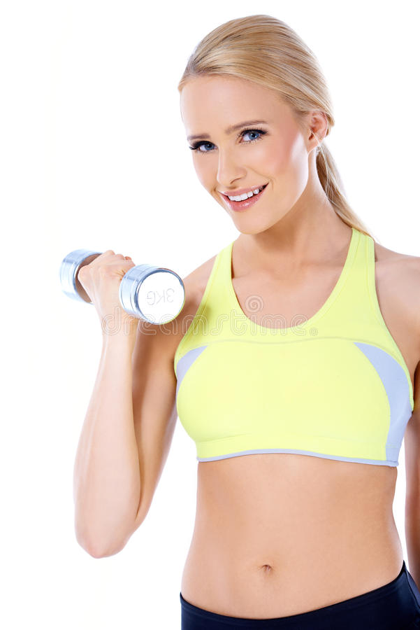 Close up of blond happy woman with dumbbell royalty free stock image