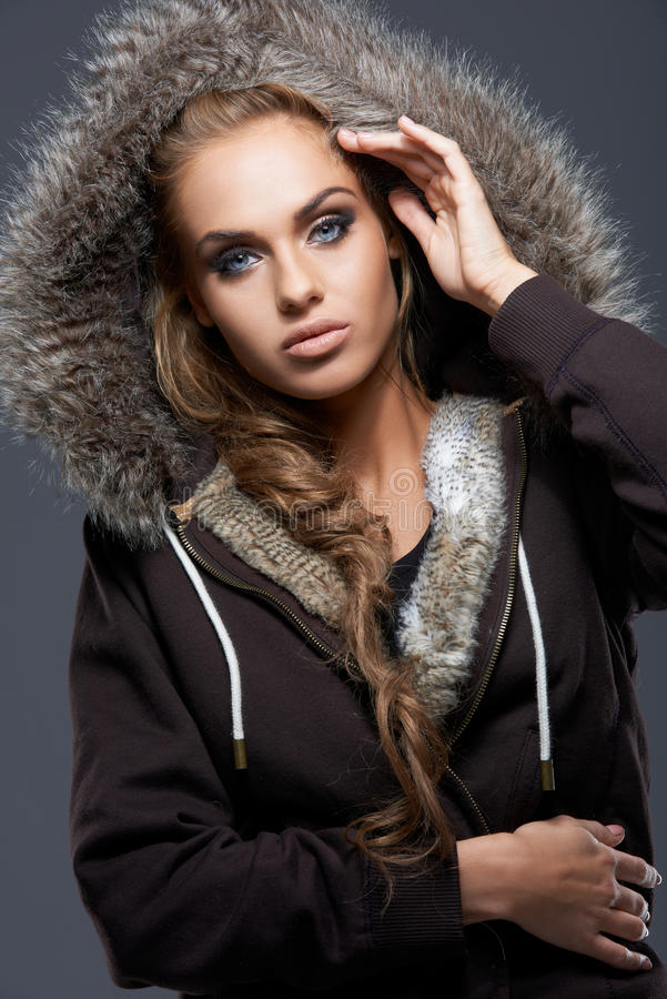 Download Close Up Of Blond Woman Wearing Hooded Sweatshirt Stock Photo - Image: 27142416