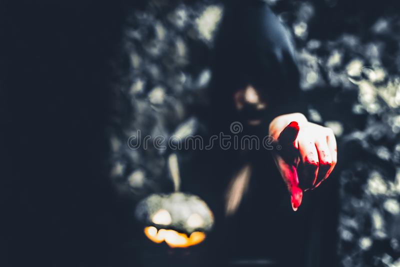 Close up of bloody wizard hand pointing to the front. Pumpkin la stock photos