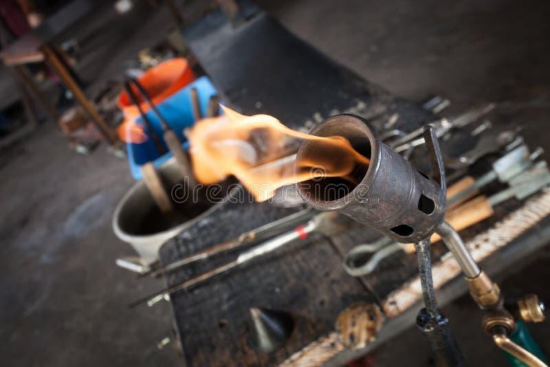 Blowtorch Close Up. Close up of blowtorch and glass making tools stock photo
