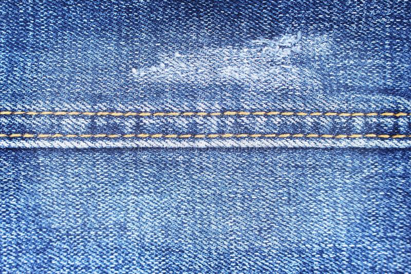 Close up blue denim texture with double thread sewing patterns , jeans fabric for background. Close up Close up blue denim texture with double thread sewing stock image