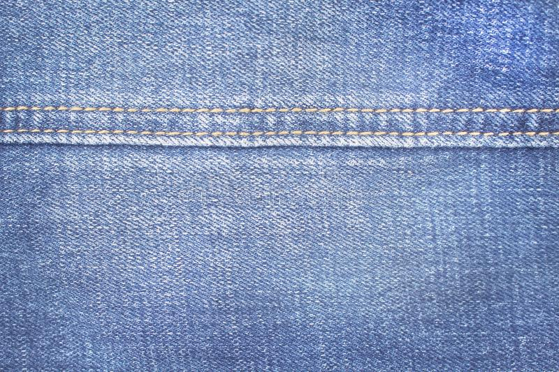 Close up blue denim texture with double thread sewing patterns , jeans fabric for background. Close up Close up blue denim texture with double thread sewing royalty free stock photography