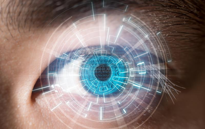 Close-up of blue eye digital scanning technology concept. In future royalty free stock photo