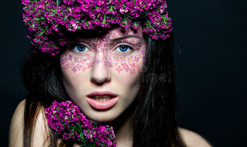 Close Up Of Blue-eyed Girl With Flowers Stock Image