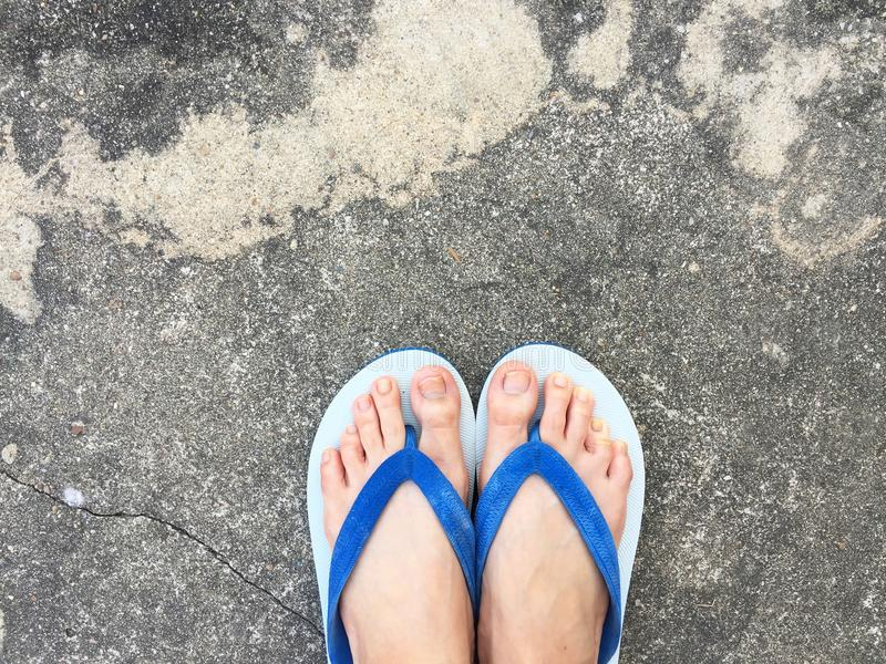 Close Up Blue Flip Flop on Cement Floor,Top view. Beautiful Woman Wearing Blue Shoes of Accessory on Concrete Background. Great For Any Use royalty free stock photo