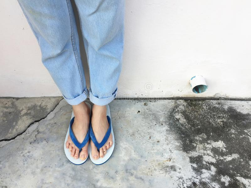 Close Up Blue Flip Flop on Cement Floor,Top view. Beautiful Woman Wearing Blue Shoes of Accessory on Concrete Background. Blue Flip Flop on Cement Floor,Top view stock photo