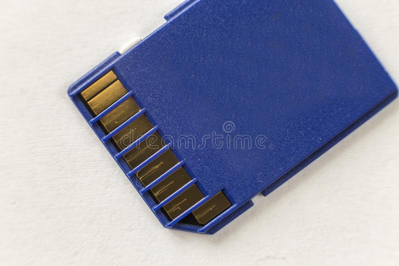 Close-up of blue micro SD memory card isolated on white copy space background. Modern electronic technology, information saving. Concept royalty free stock photo