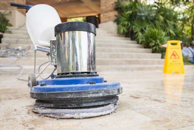 Close up blue polishing machine on the floor. Close up blue polishing machine on the stone floor royalty free stock photos