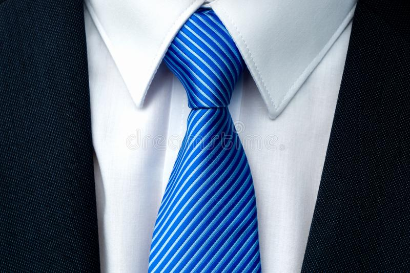 Close-up of a blue striped tie royalty free stock photo