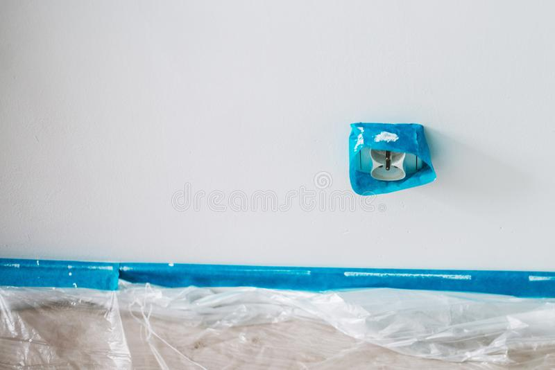 Close up on blue tape, home repair, wall painting royalty free stock images