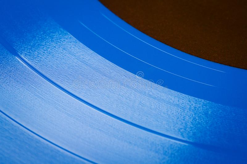 Close up of blue vinyl surface. Blue vinyl record texture background. Close up of vinyl LP record showing grooves stock image