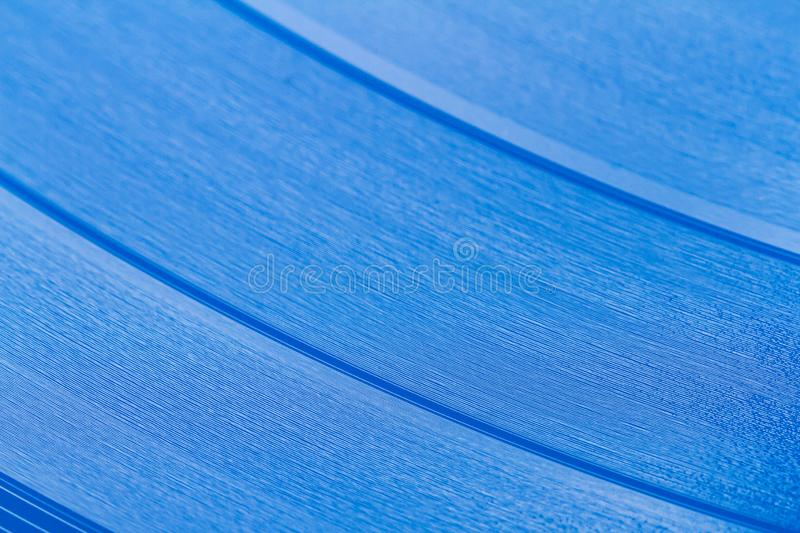 Close up of blue vinyl surface. Red vinyl record texture background. Close up of vinyl LP record showing grooves royalty free stock images