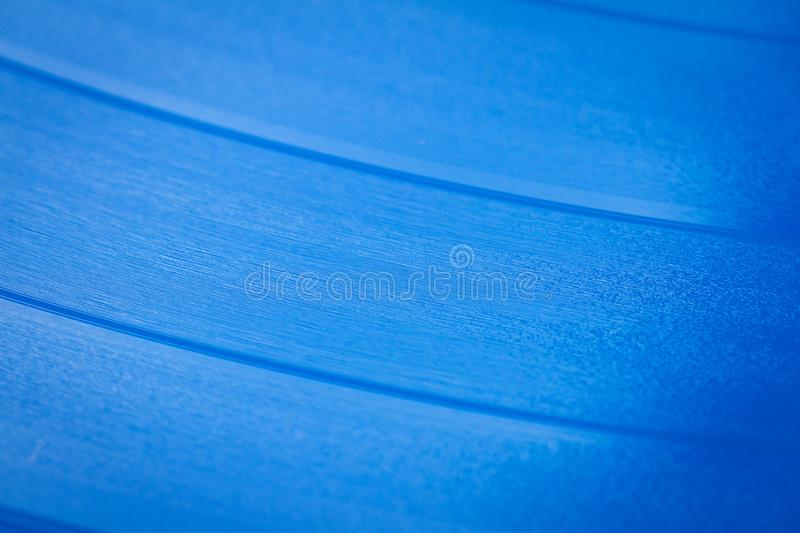 Close up of blue vinyl surface. Red vinyl record texture background. Close up of vinyl LP record showing grooves royalty free stock image