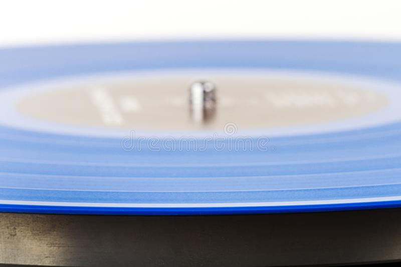 Close up of blue vinyl on turntable stock photography