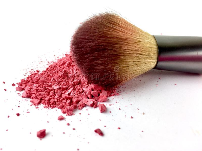 Pink powder and blush brush on a white background royalty free stock photography