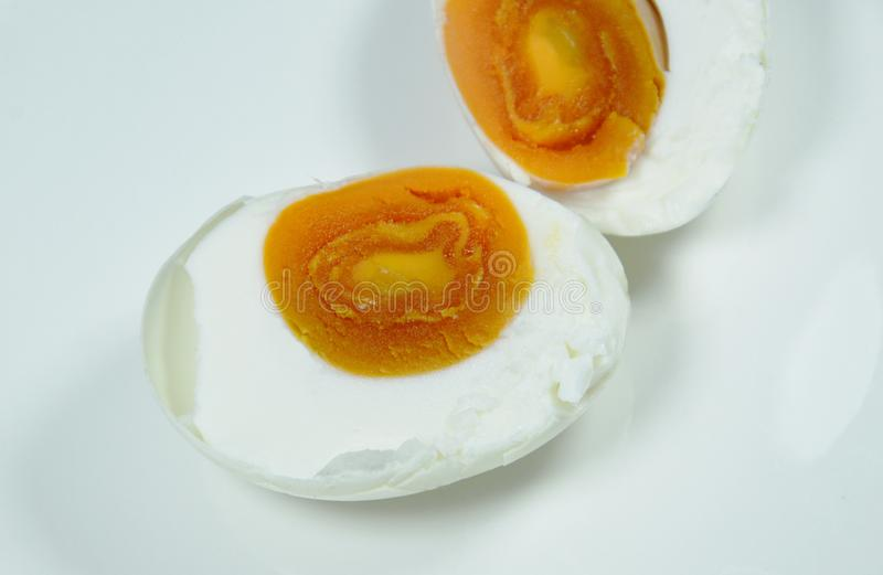 Boiled salty egg half cut on plate. Close up of boiled salty egg half cut on plate stock photos
