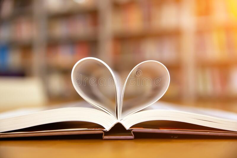 Close up book image in heart shape on the table at library room of lifestyle love to read and february valentine day stock photography