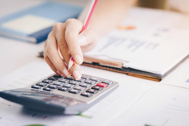 Close up of bookkeeper or financial inspector hands making report, calculating or checking balance.Investment, economy, saving mo royalty free stock image