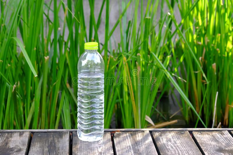 Close up a bottle of drinking water on the old wooden ground floor with royalty free stock photography