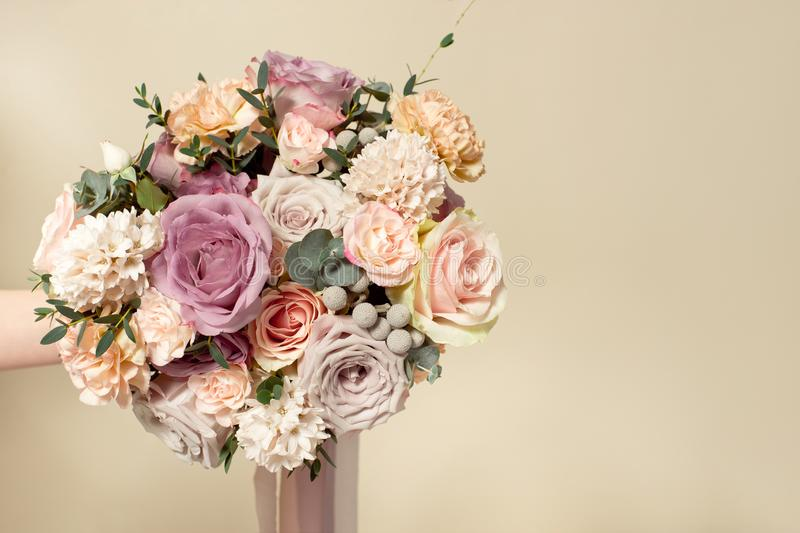 Close-up bouquet of flowers on the round white table indoors. royalty free stock photography